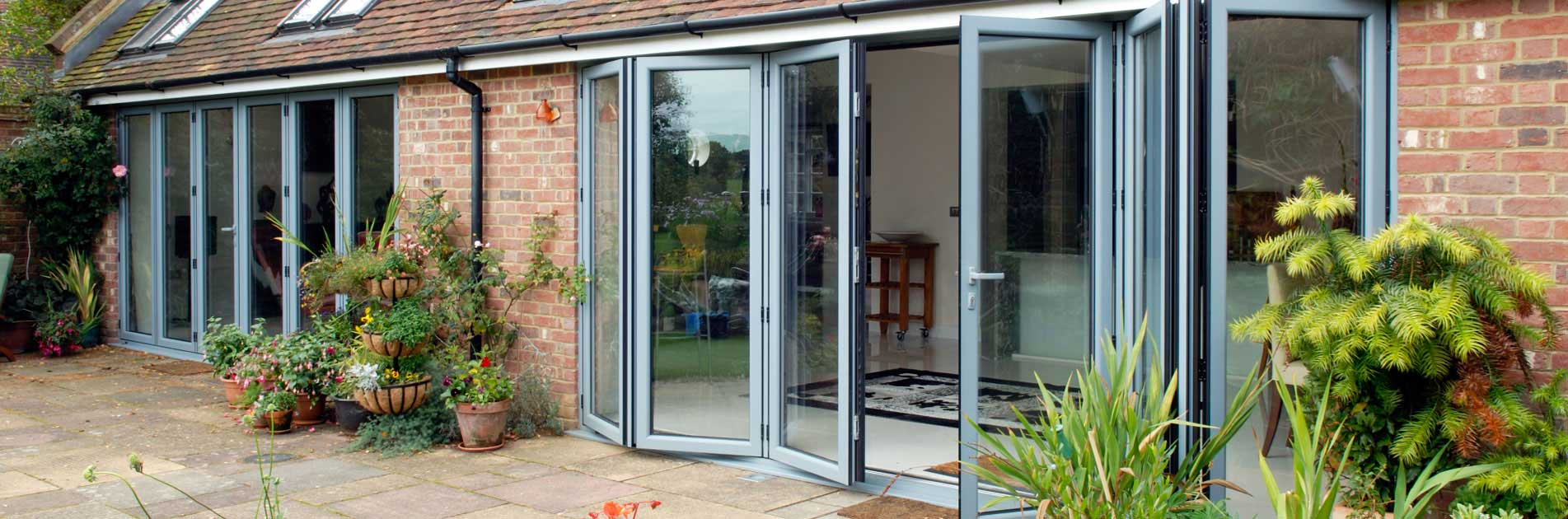 How to Re-Invent Room Space and Let the Light in With Bifold Doors