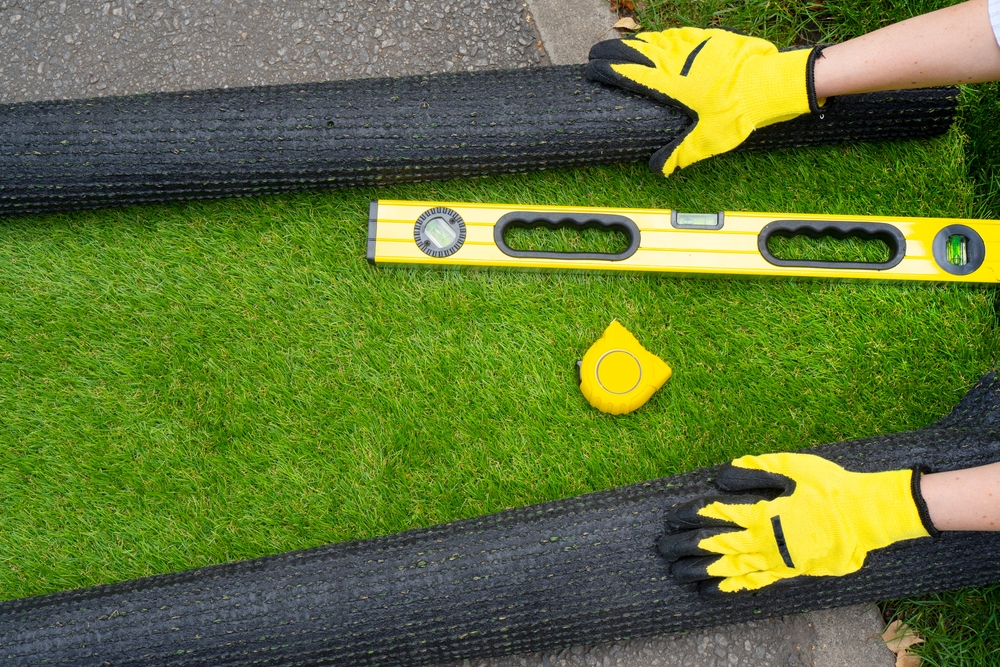Working with artificial grass in your new build's garden